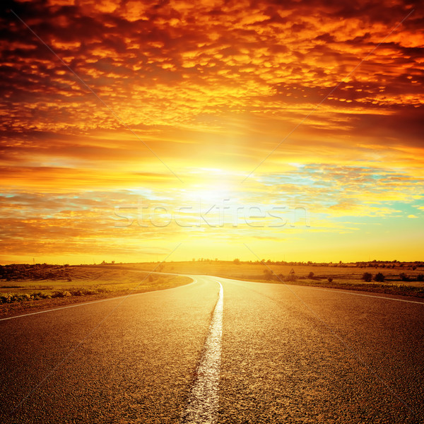 good red sunset and asphalt road to horizon Stock photo © mycola