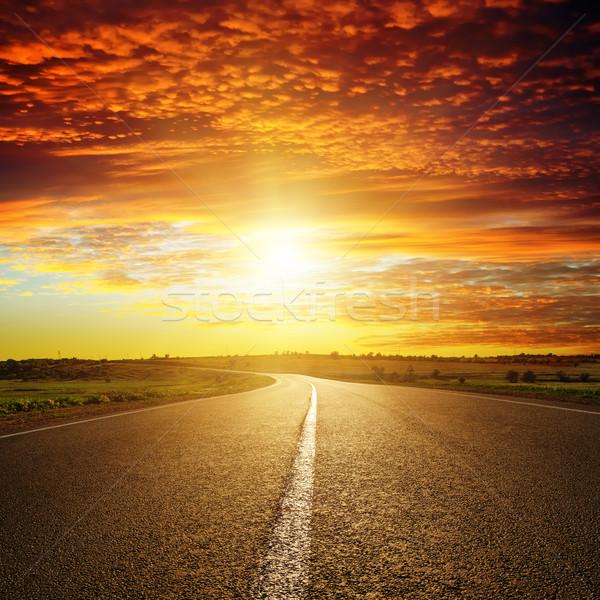 Rosso tramonto strada sole panorama tempesta Foto d'archivio © mycola