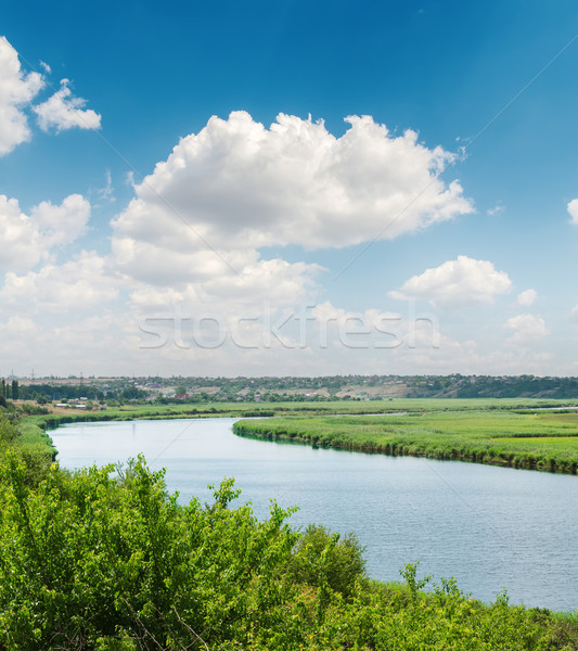 blue sky with white clouds over river in green riverside Stock photo © mycola