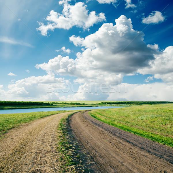 Rural estrada grama verde nublado céu água Foto stock © mycola