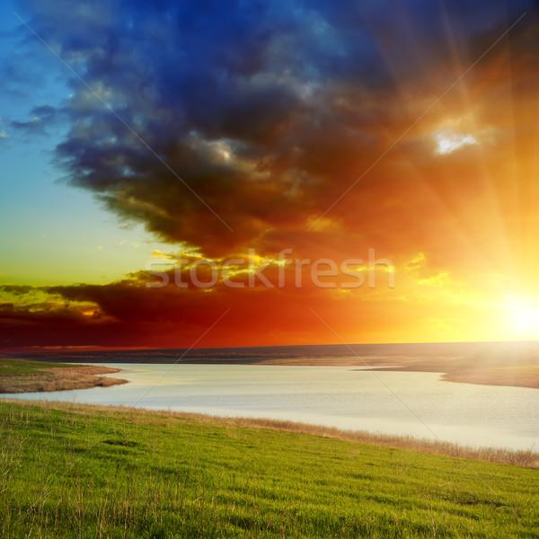 Dramatik gün batımı nehir gökyüzü su güneş Stok fotoğraf © mycola