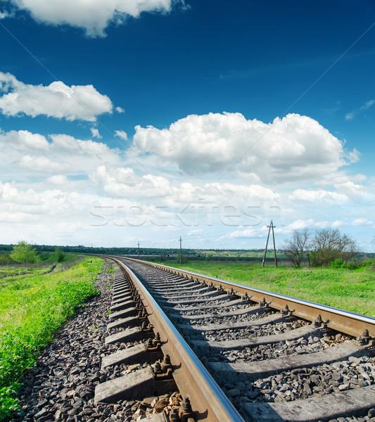 Stock photo: railroad closeup to horizon and blue sky