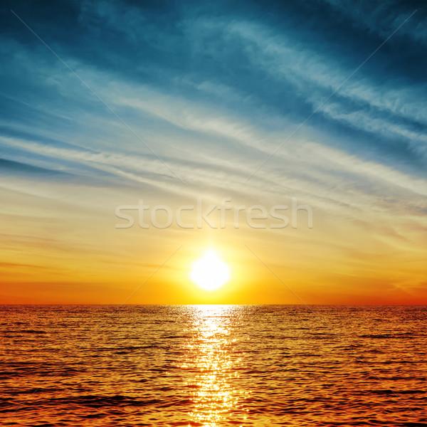 sunset over water Stock photo © mycola
