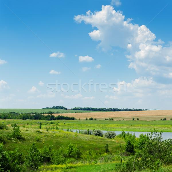 Zielone krajobraz rzeki niebieski mętny niebo Zdjęcia stock © mycola