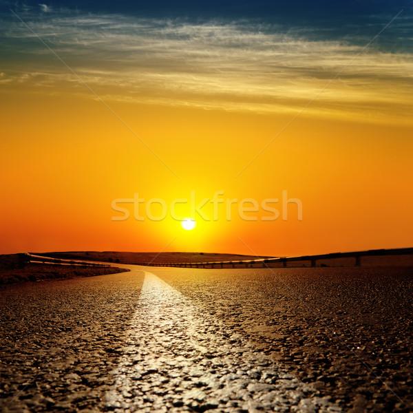 asphalt road to red sunset Stock photo © mycola