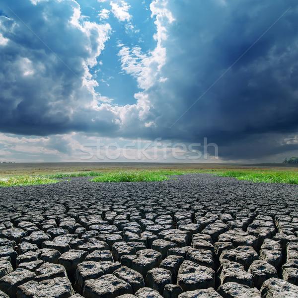 Globális felmelegedés repedt Föld sötét felhők textúra Stock fotó © mycola