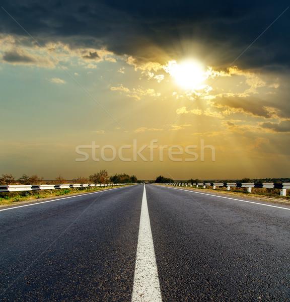 Dramatisch zonsondergang asfalt weg abstract natuur Stockfoto © mycola