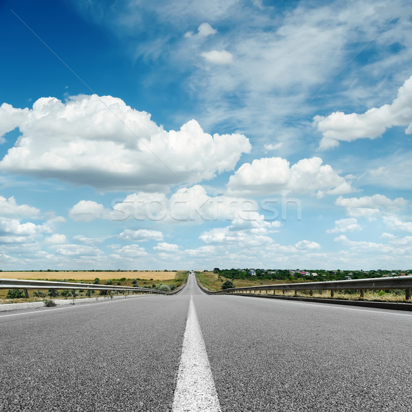 asphalt road with white line on center close up under cloudy sky Stock photo © mycola