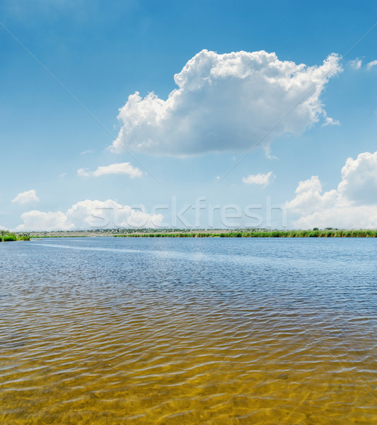 Stock photo: water in river close up and blue sky with clouds