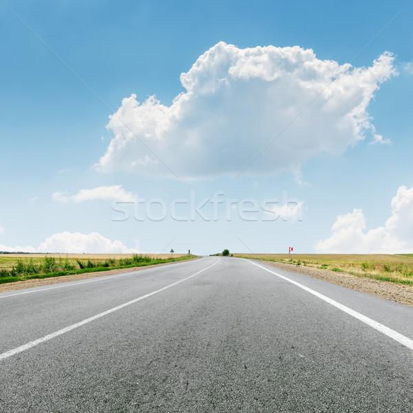 Wolk asfalt weg voorjaar gras zon Stockfoto © mycola