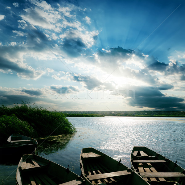 Barcos rio pôr do sol céu natureza luz Foto stock © mycola