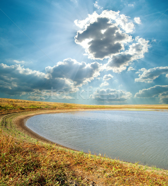 Lagoa nublado céu praia grama natureza Foto stock © mycola