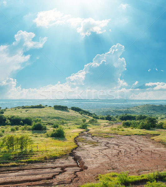 blue sky with clouds and sun over drought earth in mountains Stock photo © mycola