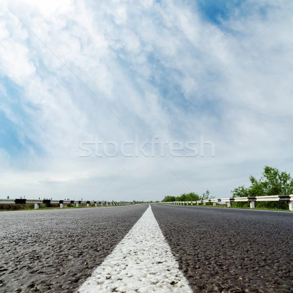 Fehér vonal aszfalt út felhők fa Stock fotó © mycola