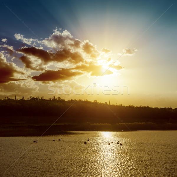 Naplemente tavacska sötét víz fény szépség Stock fotó © mycola