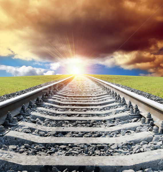 rail to sun in dramatic sky Stock photo © mycola