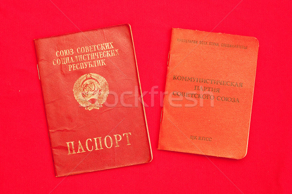 party card  of CPSU and passport over red Stock photo © mycola