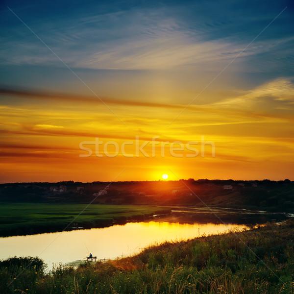 last sunrays in sky over river Stock photo © mycola