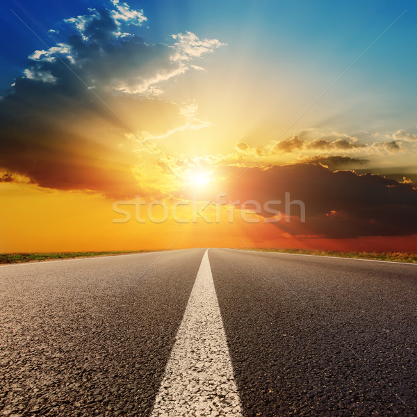 asphalt road under sunset with clouds Stock photo © mycola