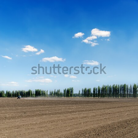 black ploughed field under blue sky Stock photo © mycola