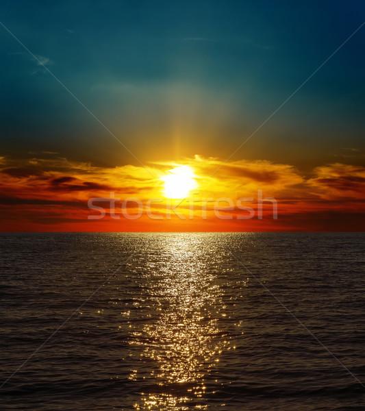 dramatic sunset over dark water Stock photo © mycola
