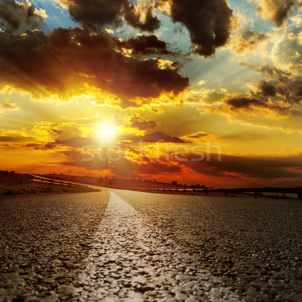 asphalt road and dramatic sunset over it Stock photo © mycola