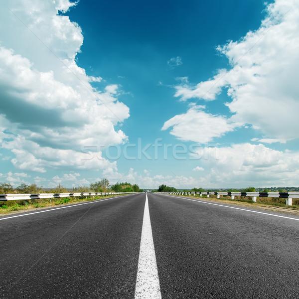 Branco linha asfalto estrada nuvens céu Foto stock © mycola