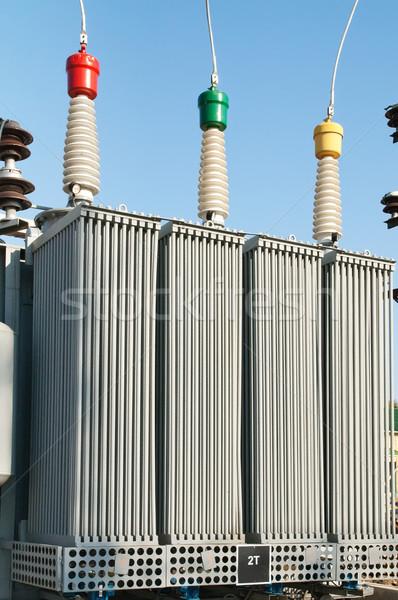 Transformateur élevé centrale électrique haute tension lumière bleu Photo stock © mycola