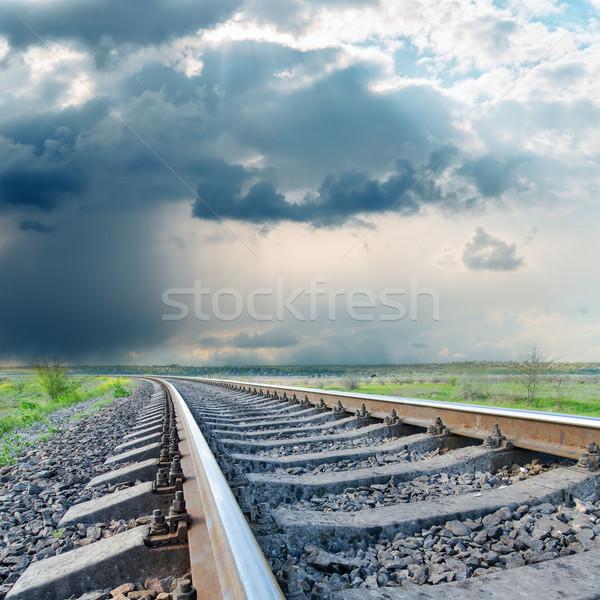 railroad to horizon under dramatic sky Stock photo © mycola