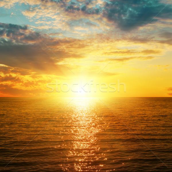 Brillante naranja puesta de sol mar cielo sol Foto stock © mycola