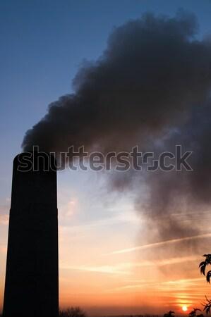 smokestack over sunset and blue sky Stock photo © mycola