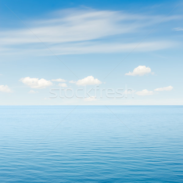 blue sea and sky with clouds over it Stock photo © mycola