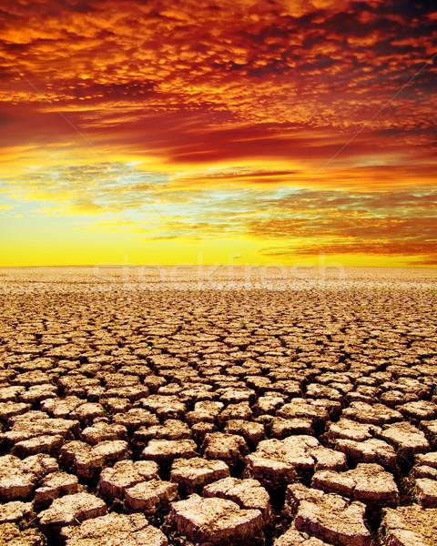 Droogte grond Rood wolken hemel landschap Stockfoto © mycola