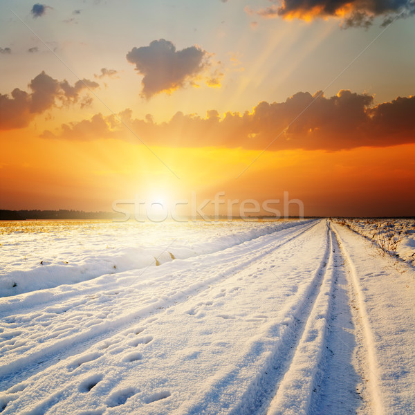 Stock photo: winter landscape. sunset over road with snow