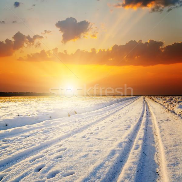 Inverno paisagem pôr do sol estrada neve céu Foto stock © mycola