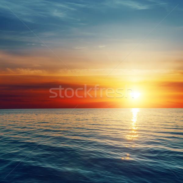 Bom vermelho pôr do sol mar paisagem fundo Foto stock © mycola