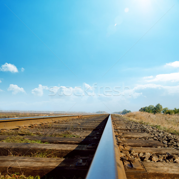 hot sun in blue sky over old railroad Stock photo © mycola