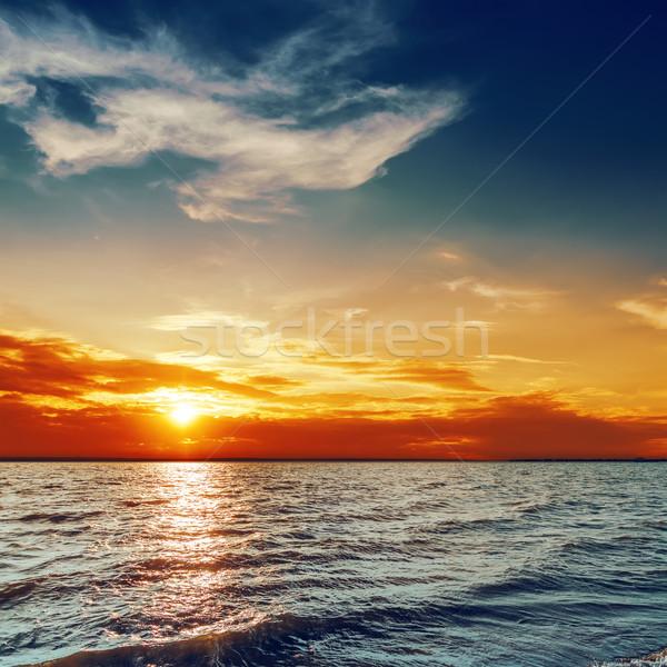 Mavi turuncu gün batımı deniz plaj gökyüzü Stok fotoğraf © mycola