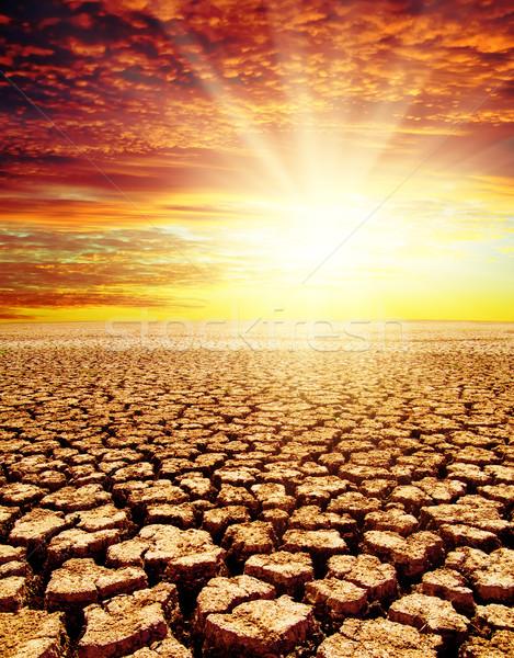 Aszály föld piros naplemente égbolt természet Stock fotó © mycola
