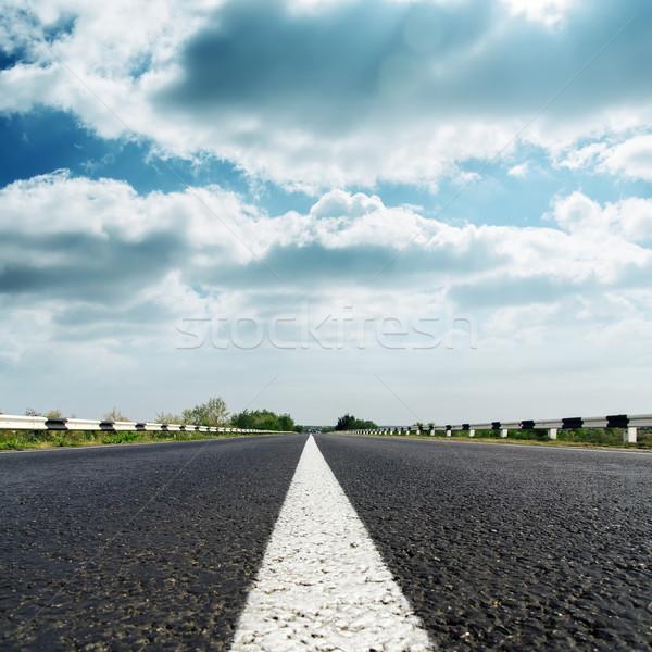 dramatic sky over asphalt road Stock photo © mycola