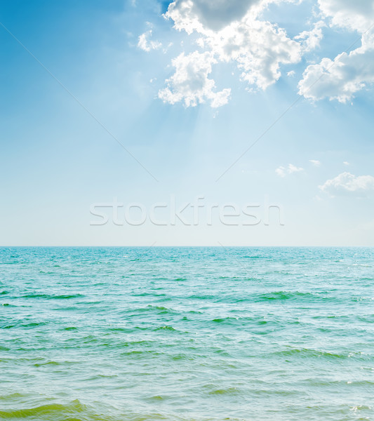 blue sea and clouds in sunrays Stock photo © mycola