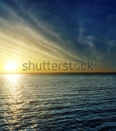 sunset with clouds over water Stock photo © mycola