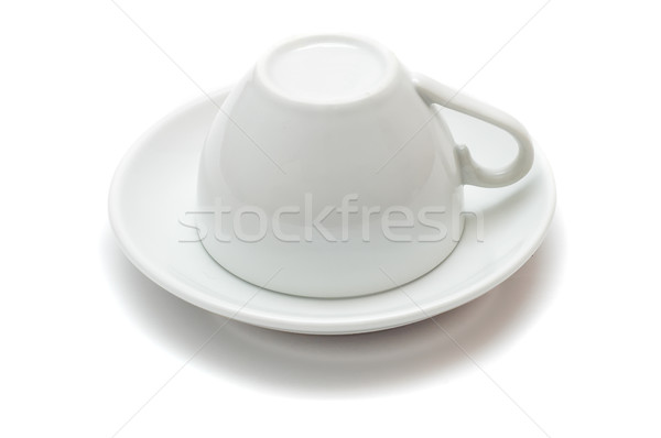 upside-down cup over saucer isolated on white background Stock photo © mycola