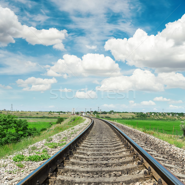 railroad to horizon in green landscape and cloudy sky Stock photo © mycola