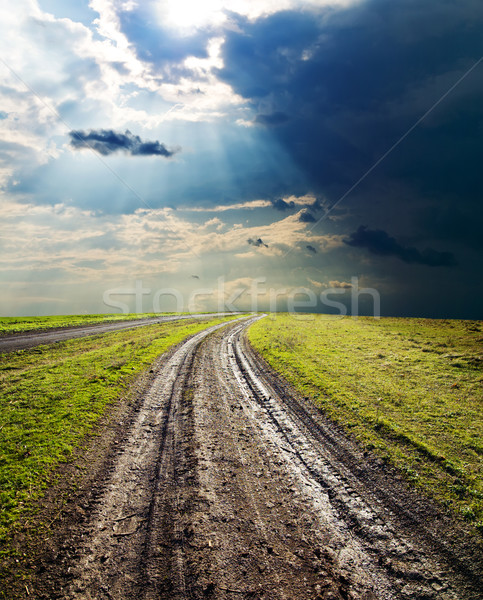 dirty road under dramatic sky Stock photo © mycola