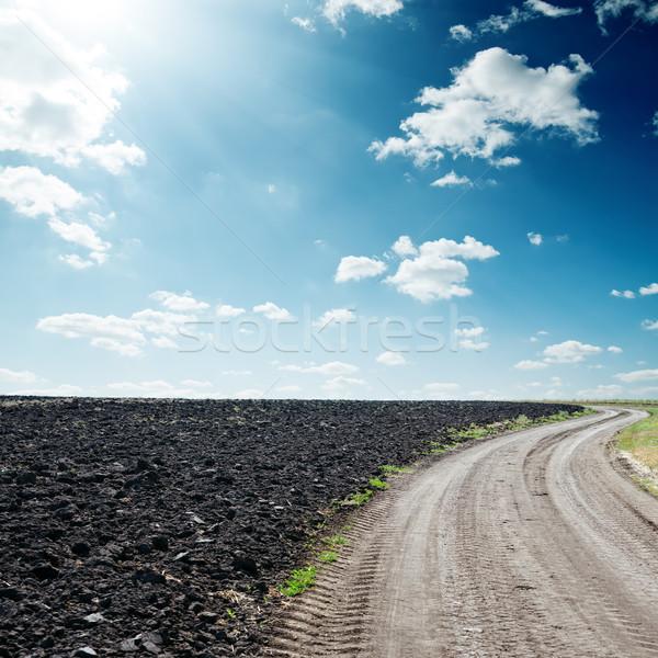 Soleil dramatique ciel route noir domaine Photo stock © mycola