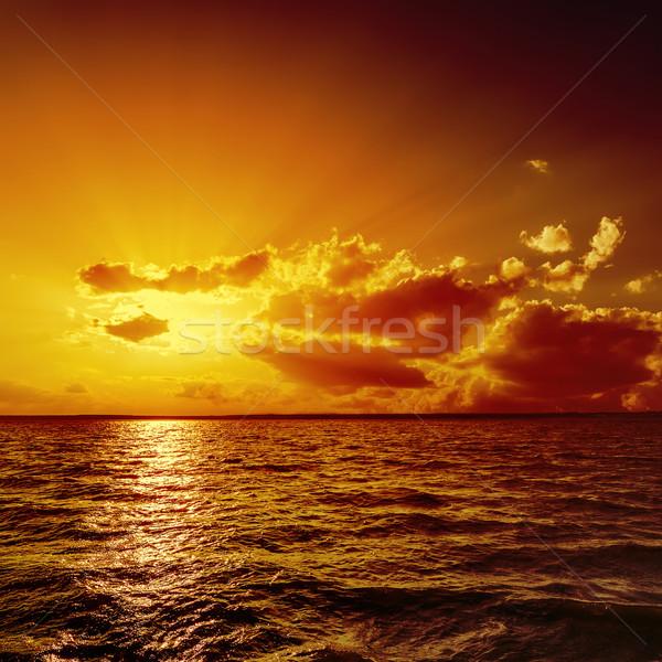 Laranja pôr do sol água nuvens luz verão Foto stock © mycola