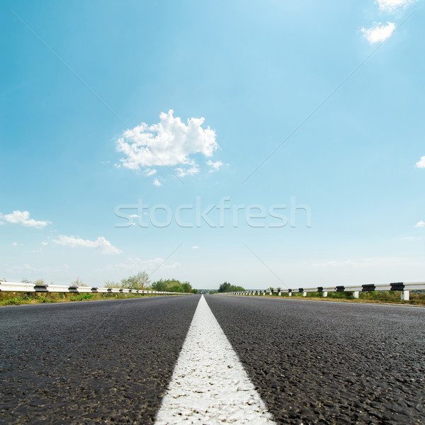 white line on asphalt road and sunny sky with clouds Stock photo © mycola