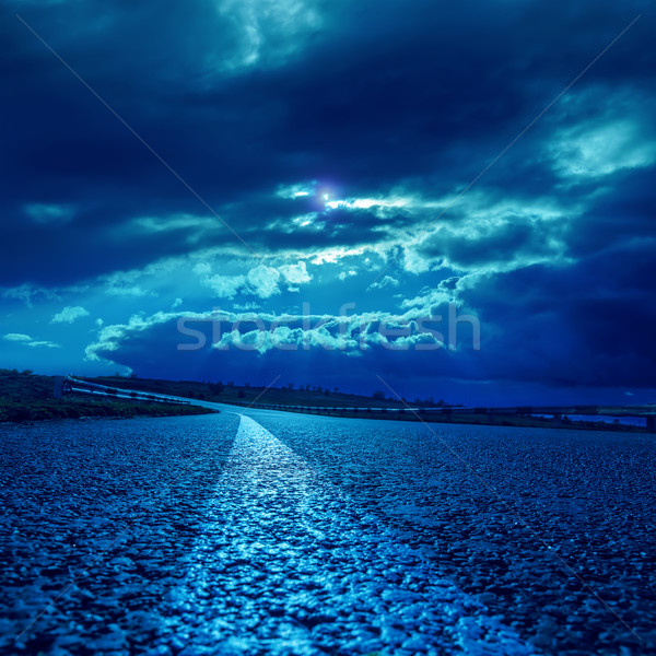 low dramatic clouds over asphalt road in dark blue moonlight Stock photo © mycola