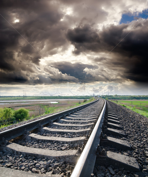 view to railroad goes to horizon under cloudy sky with sun Stock photo © mycola